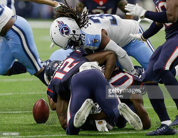 Kurtis Drummond of the Houston Texans causes a fumble in the first half against the Tennessee Titans at NRG Stadium on November 1 2015 in Houston...