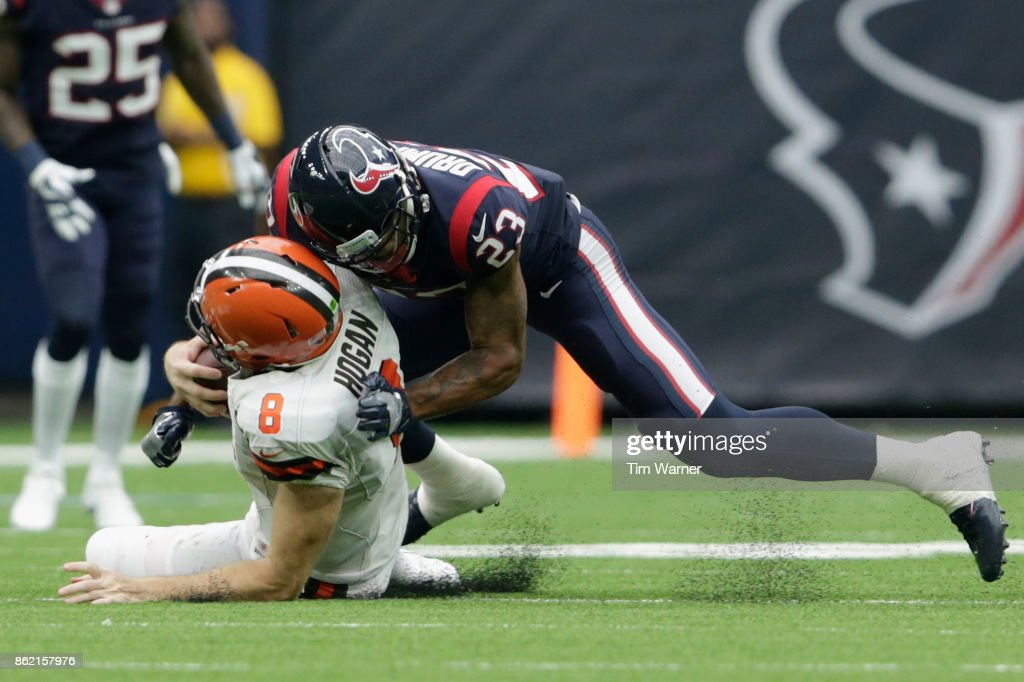 Kurtis Drummond #23 of the Houston Texans tackles Kevin Hogan #8 of the Cleveland Browns in the second half at NRG Stadium on October 15, 2017 in Houston, Texas.