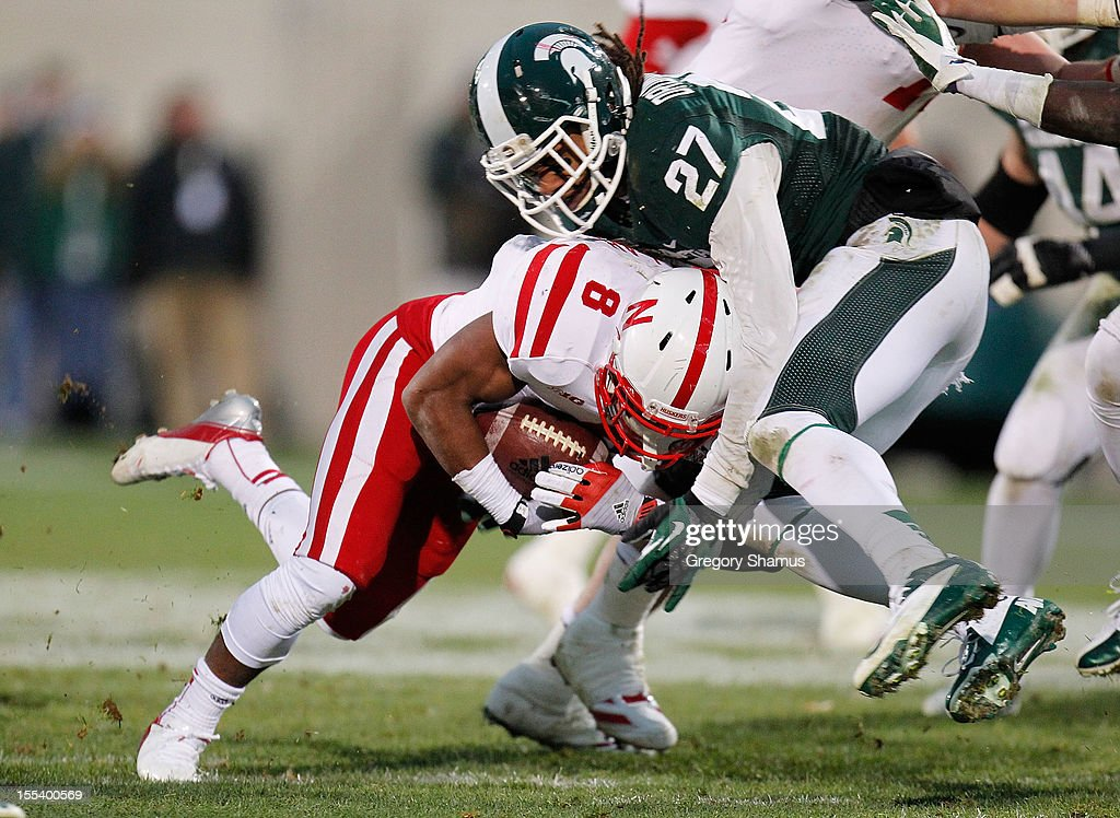 Kurtis Drummond #27 of the Michigan State Spartans tackles Ameer Abdullah #8 of the Nebraska Cornhuskers during fourth quarter action at Spartan Stadium Stadium on November 3, 2012 in East Lansing, Michigan. Nebraska won the game 28-24.