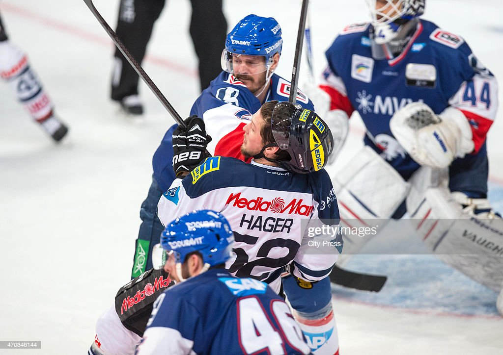 Kurtis Foster of the Adler Mannheim and Patrick Hager of ERC Ingolstadt during the game between Adler Mannheim and ERC Ingolstadt on April 19 2015 in...