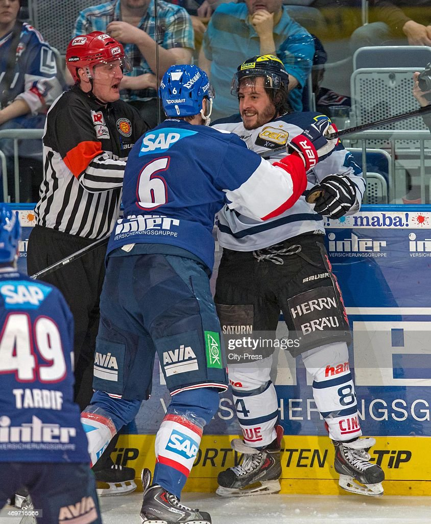 Kurtis Foster of the Adler Mannheim fights with Jean Francois Boucher of ERC Ingolstadt during the game between Adler Mannheim and ERC Ingolstadt on...