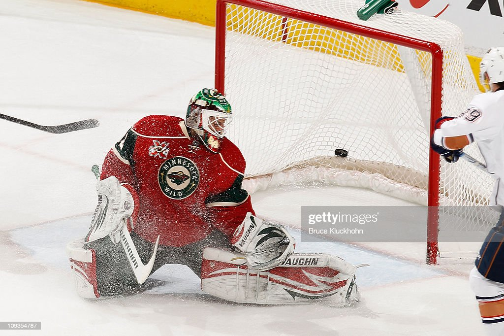 Kurtis Foster of the Edmonton Oilers scores a goal against Niklas Backstrom and the Minnesota Wild during the game at Xcel Energy Center on February...