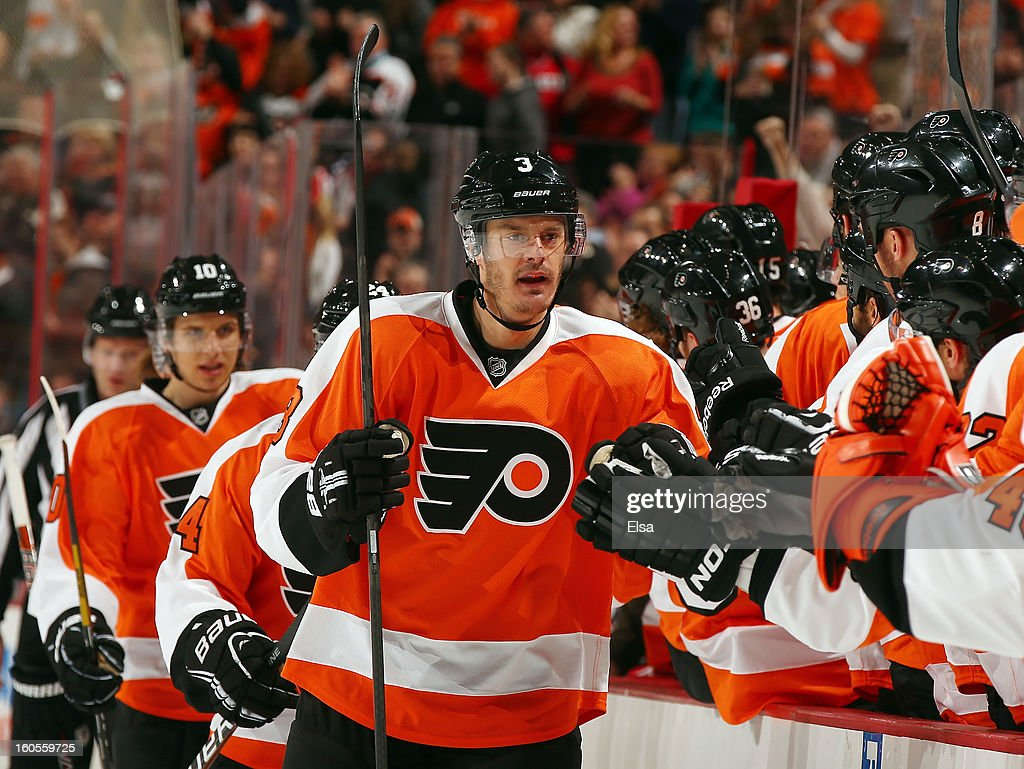 Kurtis Foster of the Philadelphia Flyers celebrates his goal with teammates on the bench in the first period against the Carolina Hurricanes on...