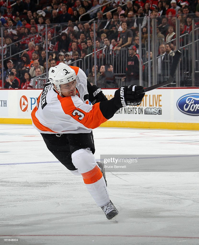 Kurtis Foster of the Philadelphia Flyers skates against the New Jersey Devils at the Prudential Center on February 15 2013 in Newark New JerseyThe...