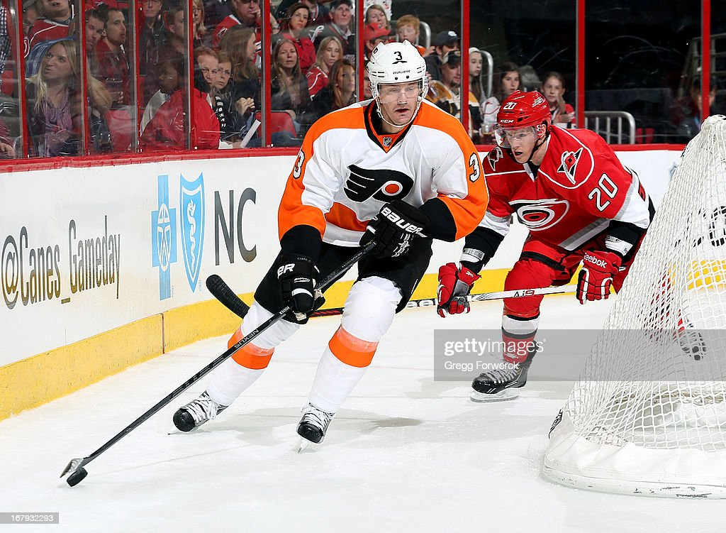 Kurtis Foster of the Philadelphia Flyers skates with the puck behind the net during their NHL game against the Carolina Hurricanes at PNC Arena on...