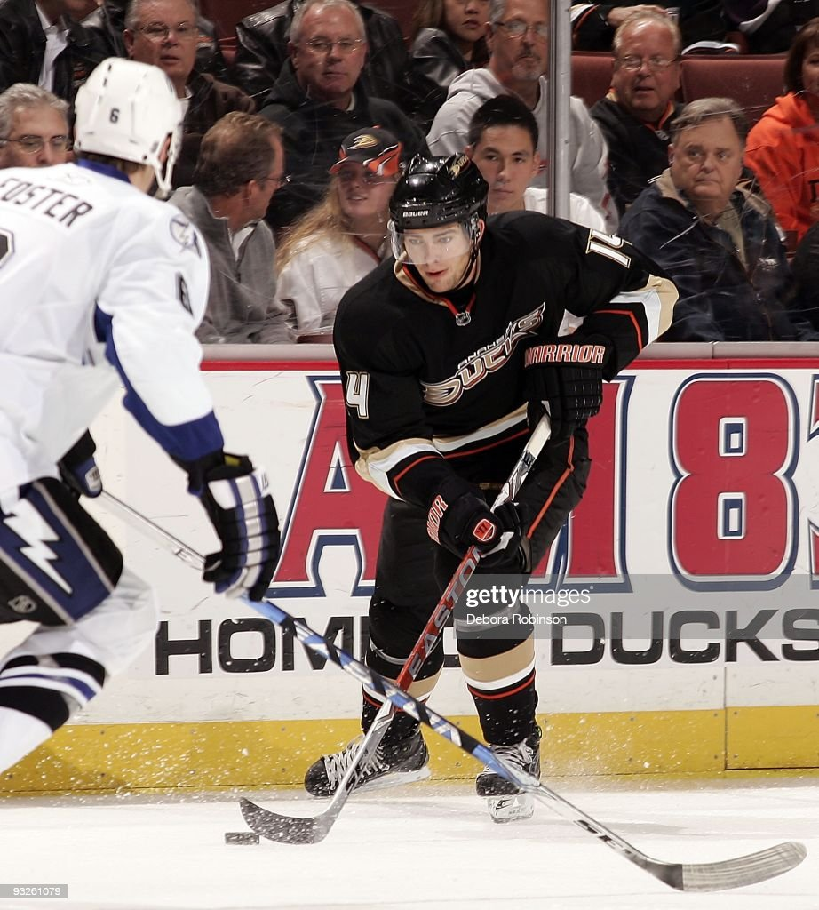 Kurtis Foster of the Tampa Bay Lighting defends against Joffrey Lupul of the Anaheim Ducks during the game on November 19 2009 at Honda Center in...