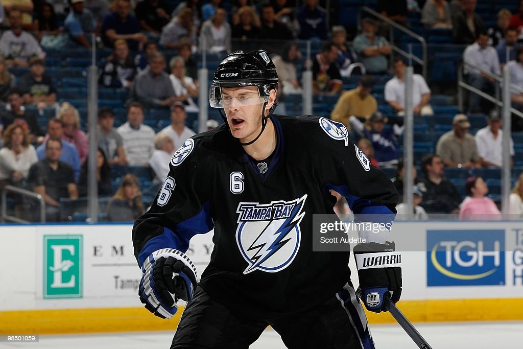 Kurtis Foster of the Tampa Bay Lightning calls for the puck while playing against the Ottawa Senators at the St Pete Times Forum on April 8 2010 in...