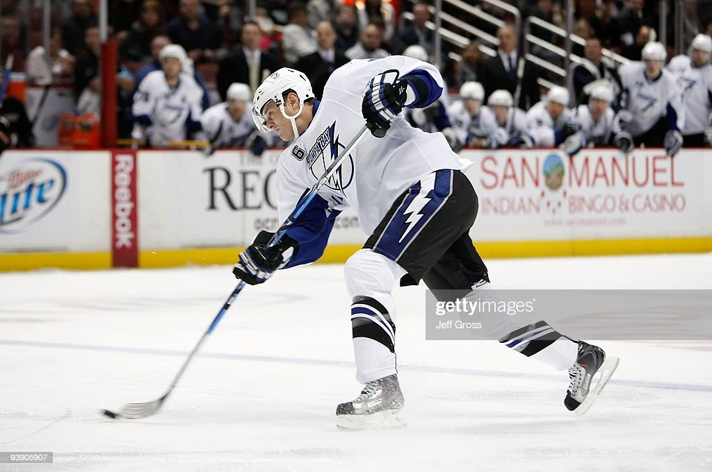 Kurtis Foster of the Tampa Bay Lightning shoots the puck against the Anaheim Ducks at the Honda Center on November 19 2009 in Anaheim California