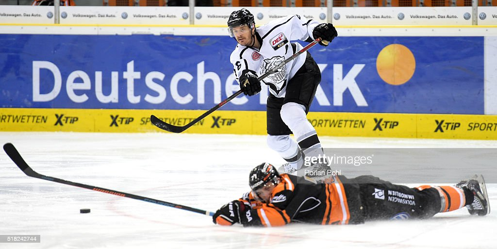 Kurtis Foster of the Thomas Sabo Ice Tigers Nuernberg and Kurtis McLean of the Grizzlys Wolfsburg during the game between the Grizzlys Wolfsburg and...