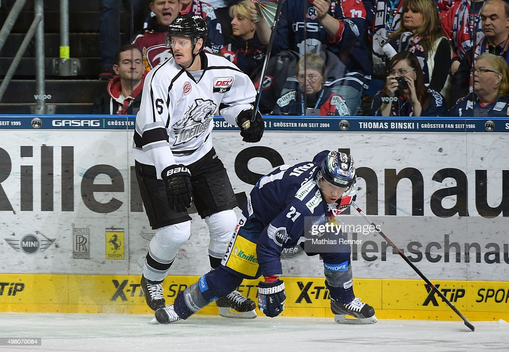 Kurtis Foster of the Thomas Sabo Ice Tigers Nuernberg zbd Shuhei Kuji of the Eisbaeren Berlin during the game between the Eisbaeren Berlin and the...
