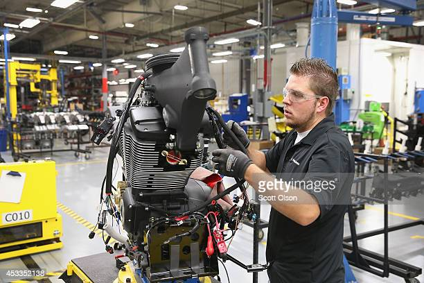 Kurtis Franzen builds a 2015 Victory Cross Country motorcycle on the assembly line at the Polaris Industries factory on August 8 2014 in Spirit Lake...