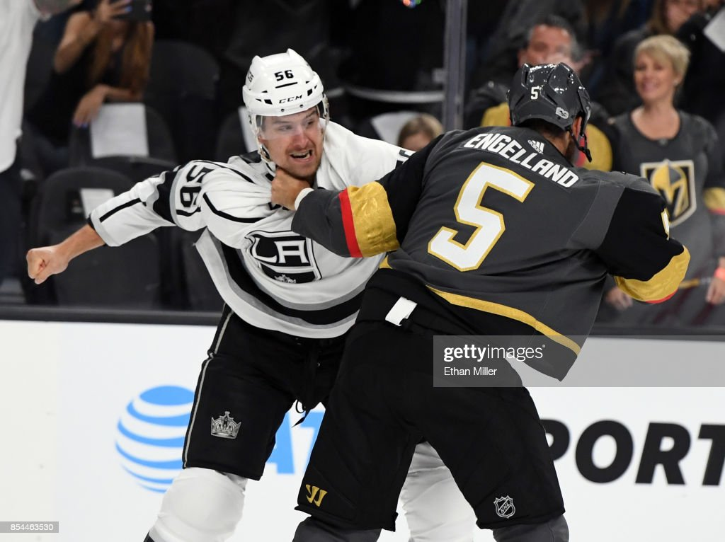 Kurtis MacDermid #56 of the Los Angeles Kings and Deryk Engelland #5 of the Vegas Golden Knights fight in the first period of their preseason game at T-Mobile Arena on September 26, 2017 in Las Vegas, Nevada.