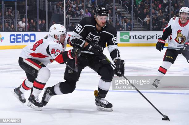Kurtis MacDermid of the Los Angeles Kings battles for the puck against JeanGabriel Pageau of the Ottawa Senators at STAPLES Center on December 7 2017...