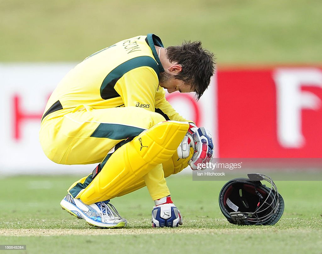 Kurtis Patterson of Australia goes down after he was hit in the head with the ball during the ICC U19 Cricket World Cup 2012 Semi Final match between Australia and South Africa at Tony Ireland Stadium on August 21, 2012 in Townsville, Australia.