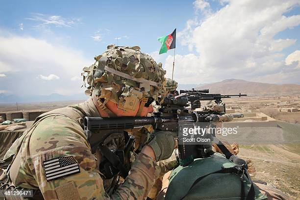 Kurtis Scheinder from Detroit Michigan with the US Army's 2nd Battalion 87th Infantry Regiment 3rd Brigade Combat Team 10th Mountain Division keeps...