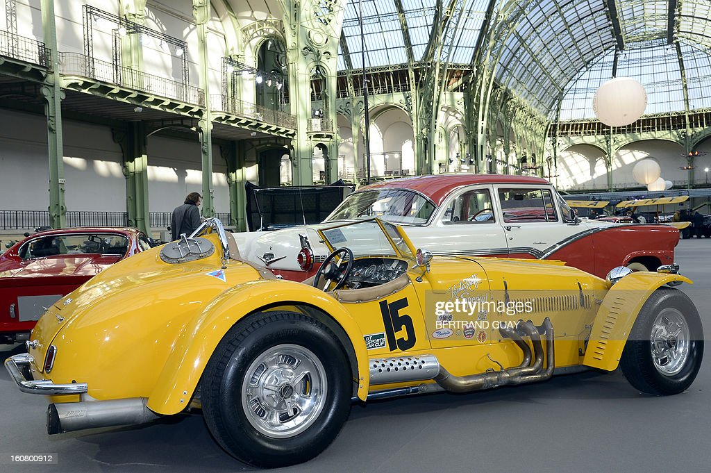 A Kurtis-Kraft 500S Sports-Racer Continuation (1953) is pictured as luxury vintages cars are displayed at an auction at the Grand Palais on February 6, 2013 in Paris. 125 vintage motor cars, 100 collection motorbikes and a 1920's Gipsy Moth plane by De Havilland, will be presented at the Bonhams auction on February 7. AFP PHOTO BERTRAND GUAY