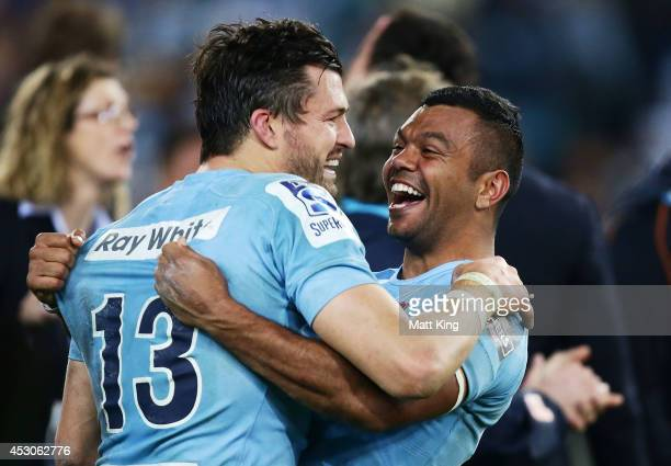 Kurtley Beale and Adam AshleyCooper of the Waratahs celebrate victory at the end of during the Super Rugby Grand Final match between the Waratahs and...