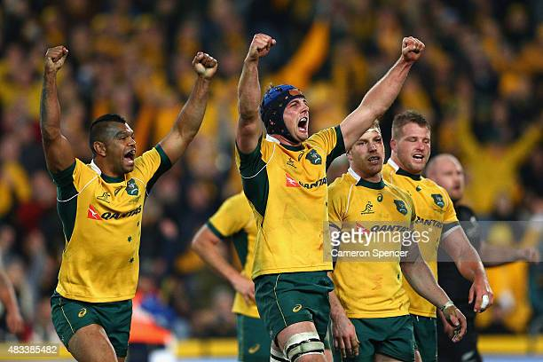 Kurtley Beale and Dean Mumm of the Wallabies celebrate winning the Rugby Championship match between the Australia Wallabies and the New Zealand All...