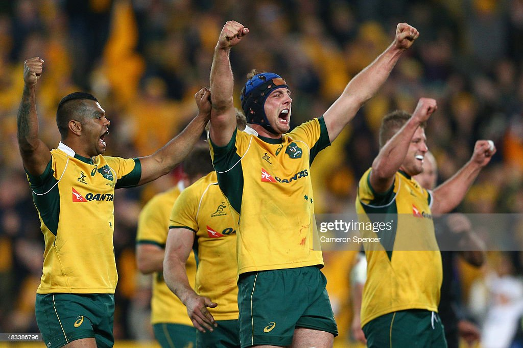 Kurtley Beale, Dean Mumm and James Slipper of the Wallabies celebrate winning the Rugby Championship match between the Australia Wallabies and the New Zealand All Blacks at ANZ Stadium on August 8, 2015 in Sydney, Australia.