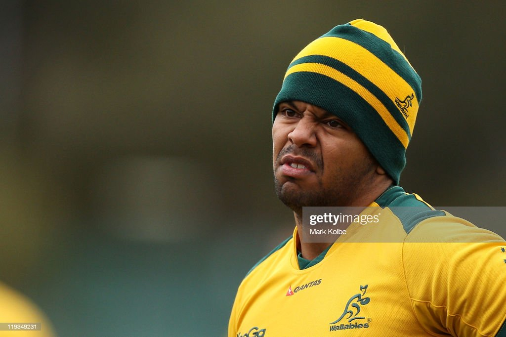 <a gi-track='captionPersonalityLinkClicked' href=/galleries/search?phrase=Kurtley+Beale&family=editorial&specificpeople=3020818 ng-click='$event.stopPropagation()'>Kurtley Beale</a> grimaces as he speaks to a team mate during an Australian Wallabies training session at Weigall Sportsground on July 19, 2011 in Sydney, Australia.