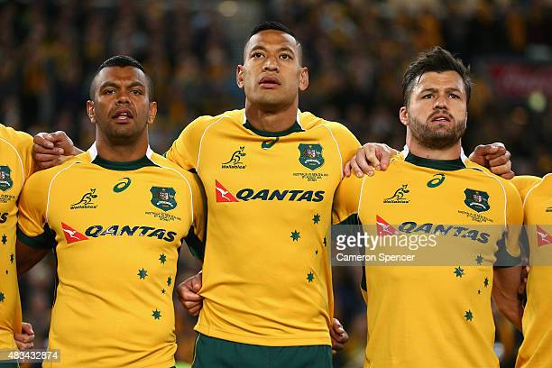 Kurtley Beale Israel Folau and Adam AshleyCooper of the Wallabies sing the Australian national anthem during The Rugby Championship match between the...