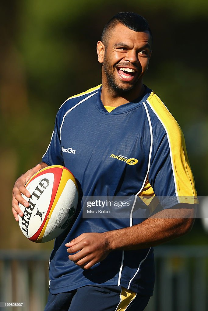 <a gi-track='captionPersonalityLinkClicked' href=/galleries/search?phrase=Kurtley+Beale&family=editorial&specificpeople=3020818 ng-click='$event.stopPropagation()'>Kurtley Beale</a> laughs as he runs the ball during a Wallabies training session at St Josephs College on June 3, 2013 in Sydney, Australia.