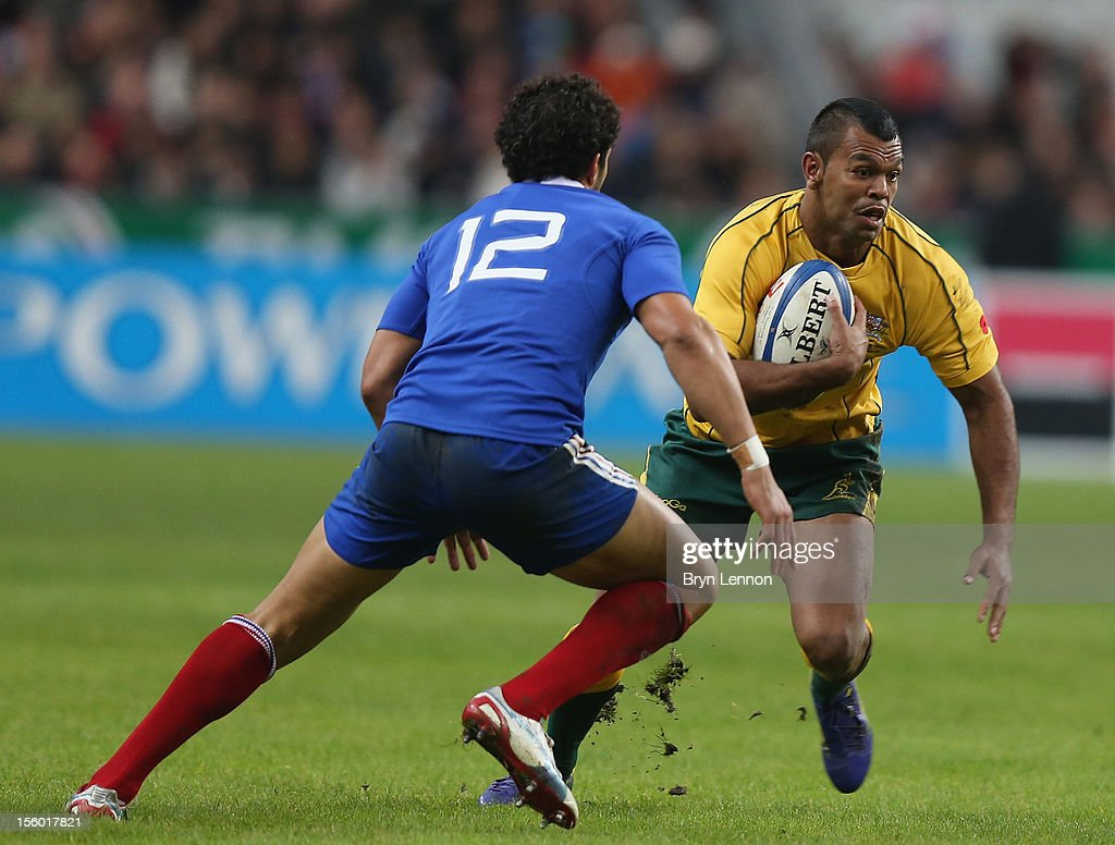 Kurtley Beale of Australia avoids Maxime Mermoz of France during the Autumn International match between France and Australia at Stade de France on November 10, 2012 in Paris, France.