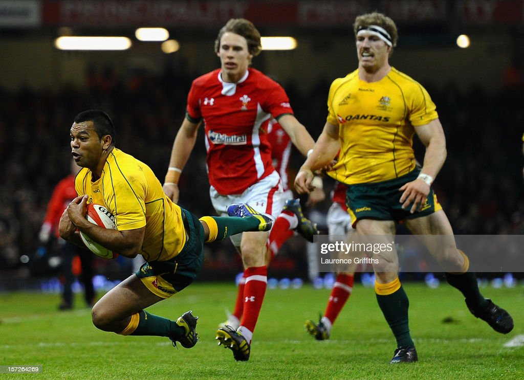 <a gi-track='captionPersonalityLinkClicked' href=/galleries/search?phrase=Kurtley+Beale&family=editorial&specificpeople=3020818 ng-click='$event.stopPropagation()'>Kurtley Beale</a> of Australia dives to take the ball during the International match between Wales and Australia at Millennium Stadium on December 1, 2012 in Cardiff, Wales.