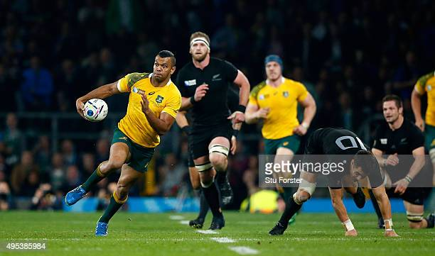 Kurtley Beale of Australia goes past Dan Carter of New Zealand during the 2015 Rugby World Cup Final match between New Zealand and Australia at...
