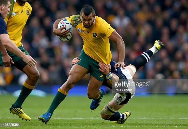 Kurtley Beale of Australia is tackled by Peter Horne of Scotland during the 2015 Rugby World Cup Quarter Final match between Australia and Scotland...