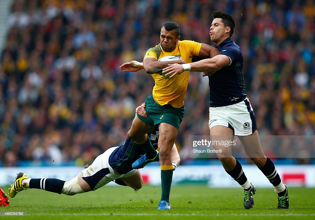 Kurtley Beale of Australia is tackled by Sean Maitland of Scotland during the 2015 Rugby World Cup Quarter Final match between Australia and Scotland...