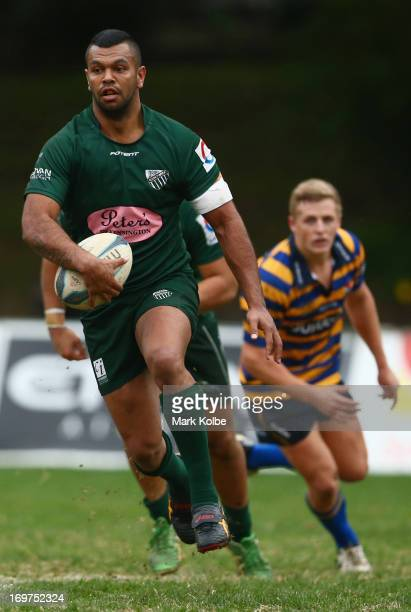 Kurtley Beale of Randwick runs the ball during the round nine Shute Shield match between Sydney University and Randwick at University Oval No 1 on...