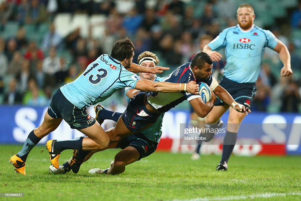 Kurtley Beale of the Rebels dives over to score a try during the round three Super Rugby match between the Waratahs and the Rebels at Allianz Stadium on March 1, 2013 in Sydney, Australia.