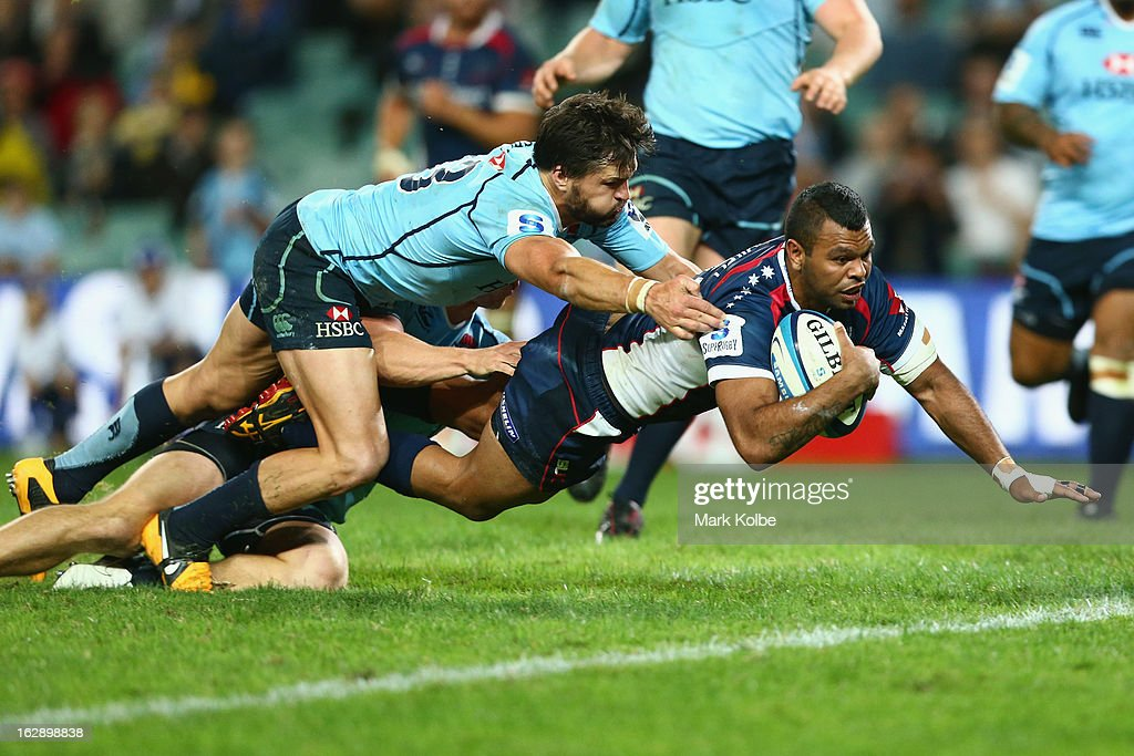 <a gi-track='captionPersonalityLinkClicked' href=/galleries/search?phrase=Kurtley+Beale&family=editorial&specificpeople=3020818 ng-click='$event.stopPropagation()'>Kurtley Beale</a> of the Rebels dives over to score a try during the round three Super Rugby match between the Waratahs and the Rebels at Allianz Stadium on March 1, 2013 in Sydney, Australia.