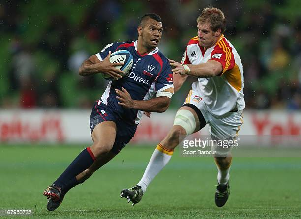 Kurtley Beale of the Rebels runs in to score a try during the round 12 Super Rugby match between the Rebels and the Chiefs at AAMI Park on May 3 2013...