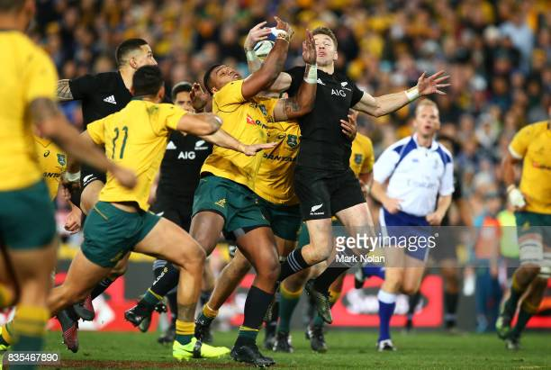 Kurtley Beale of the Wallabies and Damian McKenzie of the All Blacks contest possession during The Rugby Championship Bledisloe Cup match between the...