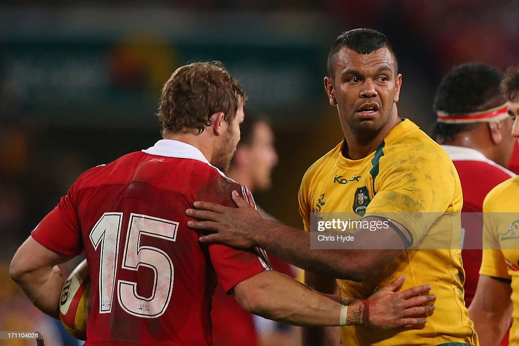 Kurtley Beale of the Wallabies and Leigh Halfpenny of the British & Irish Lions shake hands after the First Test match between the Australian Wallabies and the British & Irish Lions at Suncorp Stadium on June 22, 2013 in Brisbane, Australia.
