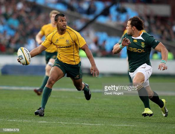 Kurtley Beale of the Wallabies breaks away to set up a try for James O'Connor during the 2010 TriNations match between the South African Springboks...