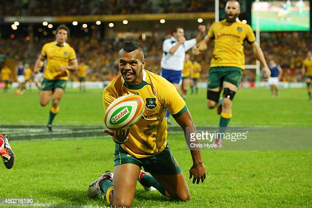 Kurtley Beale of the Wallabies celebrates scoring a try during the First International Test Match between the Australian Wallabies and France at...