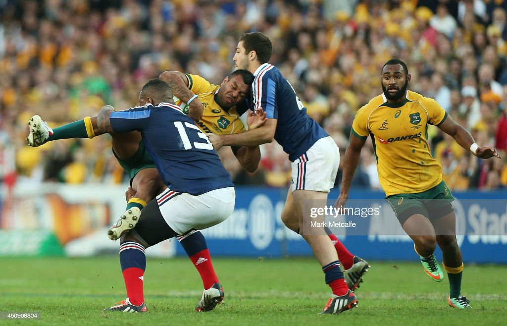 Kurtley Beale of the Wallabies is tackled by Mathieu Bastareaud of France during the International Test match between the Australia Wallabies and France at Allianz Stadium on June 21, 2014 in Sydney, Australia.