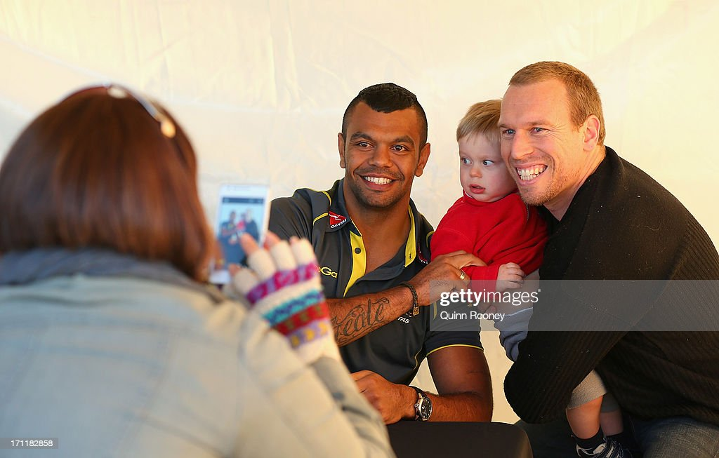 <a gi-track='captionPersonalityLinkClicked' href=/galleries/search?phrase=Kurtley+Beale&family=editorial&specificpeople=3020818 ng-click='$event.stopPropagation()'>Kurtley Beale</a> of the Wallabies poses for photos with fans during an Australian Wallabies fan day on June 23, 2013 in Melbourne, Australia.