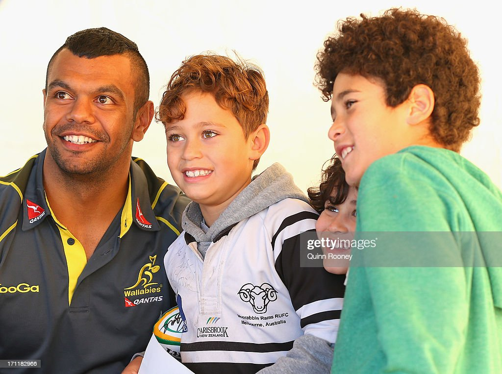 Kurtley Beale of the Wallabies poses for photos with fans during an Australian Wallabies fan day on June 23, 2013 in Melbourne, Australia.