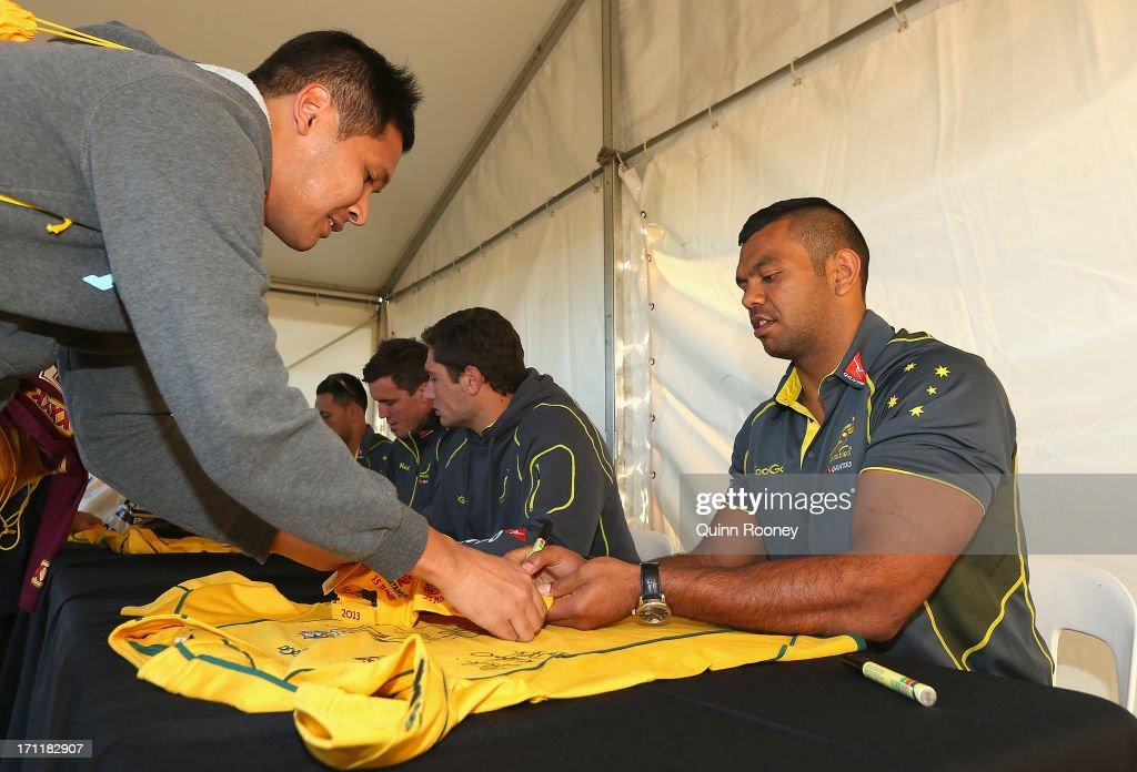 Kurtley Beale of the Wallabies signs autographs during an Australian Wallabies fan day on June 23, 2013 in Melbourne, Australia.