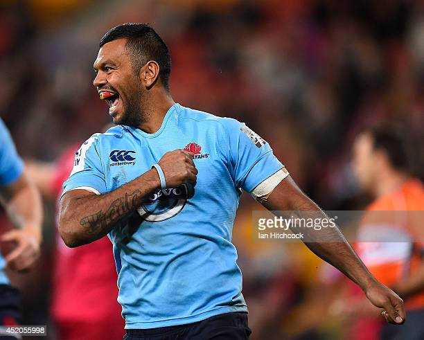 Kurtley Beale of the Waratahs celebrates after scoring a try during the round 19 Super Rugby match between the Reds and the Waratahs at Suncorp...
