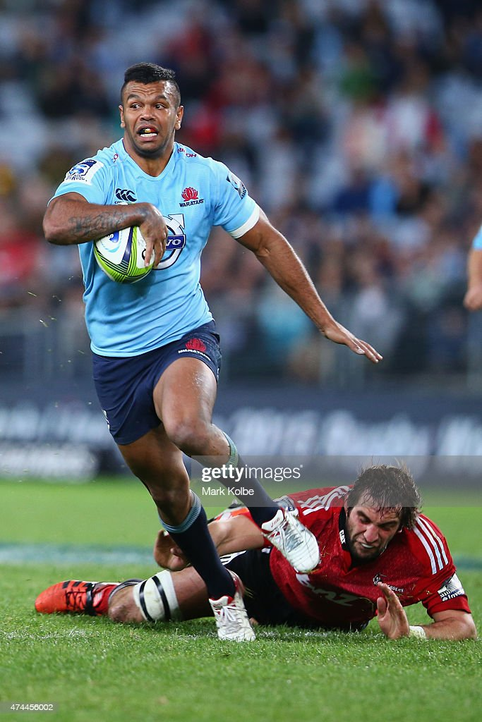 <a gi-track='captionPersonalityLinkClicked' href=/galleries/search?phrase=Kurtley+Beale&family=editorial&specificpeople=3020818 ng-click='$event.stopPropagation()'>Kurtley Beale</a> of the Waratahs evades the tackle of <a gi-track='captionPersonalityLinkClicked' href=/galleries/search?phrase=Sam+Whitelock&family=editorial&specificpeople=6070892 ng-click='$event.stopPropagation()'>Sam Whitelock</a> of the Crusaders during the round 15 Super Rugby match between the Waratahs and the Crusaders at ANZ Stadium on May 23, 2015 in Sydney, Australia.