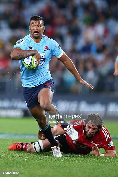 Kurtley Beale of the Waratahs evades the tackle of Sam Whitelock of the Crusaders during the round 15 Super Rugby match between the Waratahs and the...