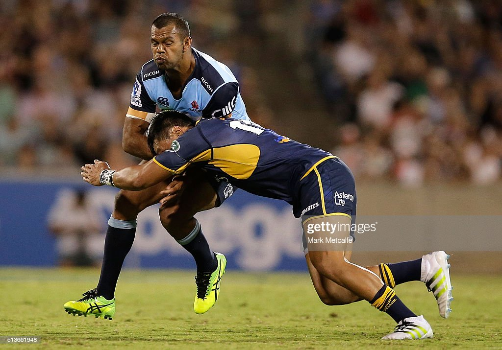 Kurtley Beale of the Waratahs is tackled by Christian Lealiifano of the Brumbies during the round two NRL match between the Brumbies and the Waratahs...
