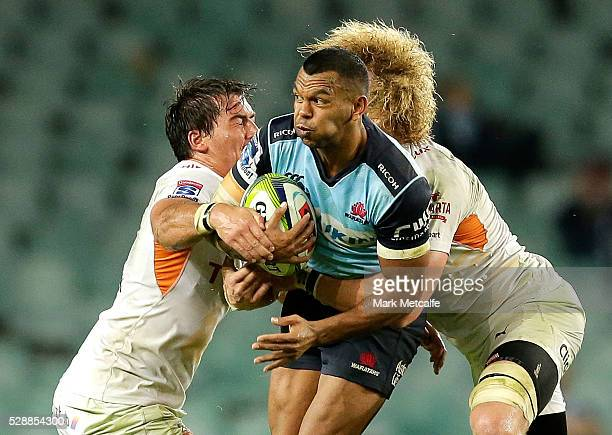 Kurtley Beale of the Waratahs is tackled during the round 11 Super Rugby match between the Waratahs and the Cheetahs at Allianz Stadium on May 7 2016...