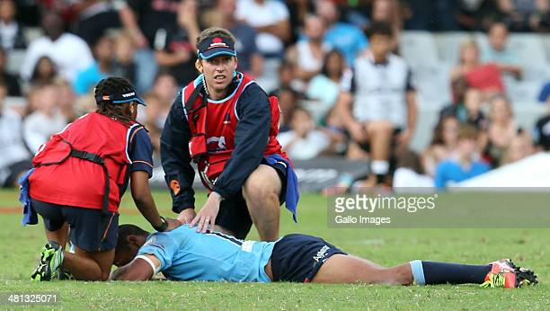 Kurtley Beale of the Waratahs lies on the ground injured during the Super Rugby match between Cell C Sharks and Waratahs at Growthpoint Kings Park on...