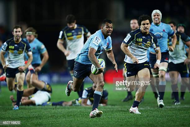 Kurtley Beale of the Waratahs makes a break on the way to scoring a try during the Super Rugby Semi Final match between the Waratahs and the Brumbies...